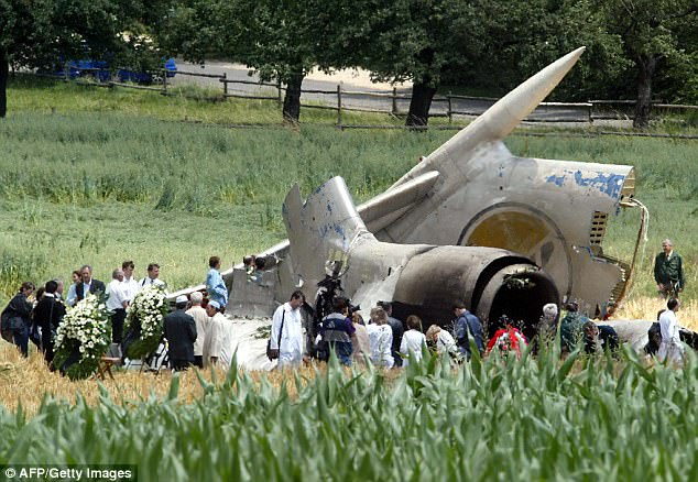 Relatives of victims are pictured where the wreckage of the crashed Russian Tupolev 154 passenger plane, was found close to Uberlingen, after a commemorative service