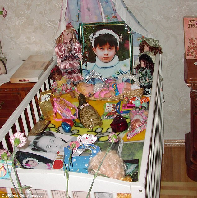 The portrait, bed and toys of a four-year-old Diana, daughter of Vitaly Kaloyev, in a shrine he made for her