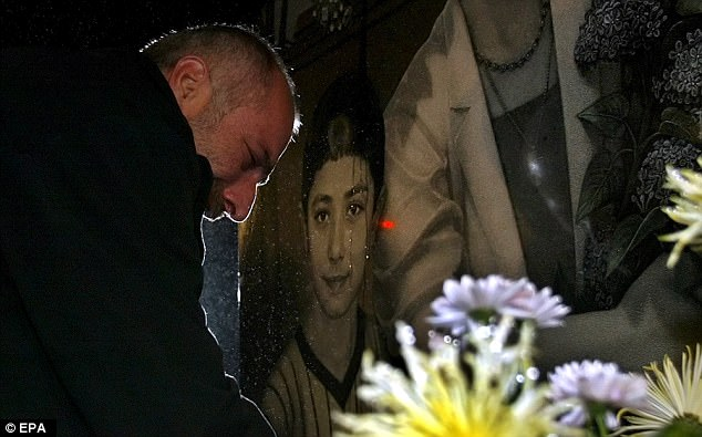 Vitaly Kaloyev, released from Swiss prison, stands in front of a tomb of his wife and two children